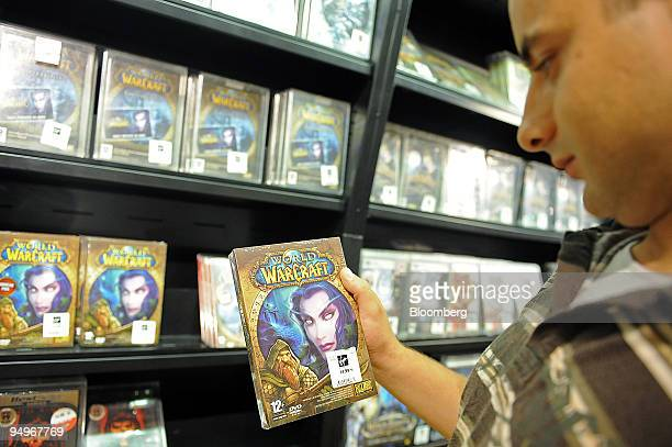 Ali Guettouche looks at a World of Warcraft video game on display at a store in Paris France on Tuesday Sept 1 2009 Vivendi SA owner of the world's...