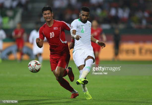 Ali Hadi Albulayhi of Saudi Arabia competes for the ball with Pak KwangRyong of North Korea during the AFC Asian Cup Group E match between Saudi...