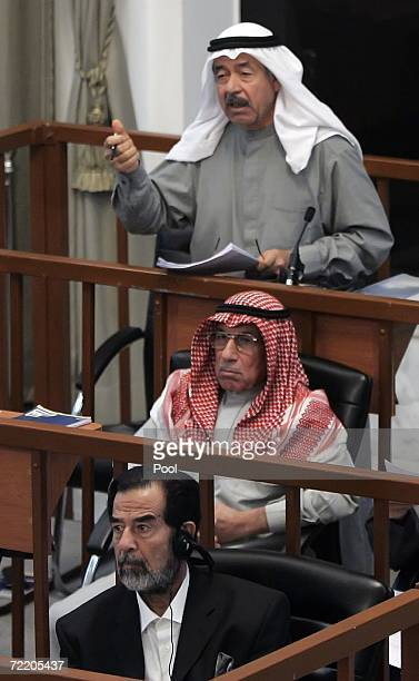Ali Hasan alMajid addresses the court as Husain Rashid Mohammed alTikriti and Saddam Hussein sit during their trial in the heavily fortified Green...