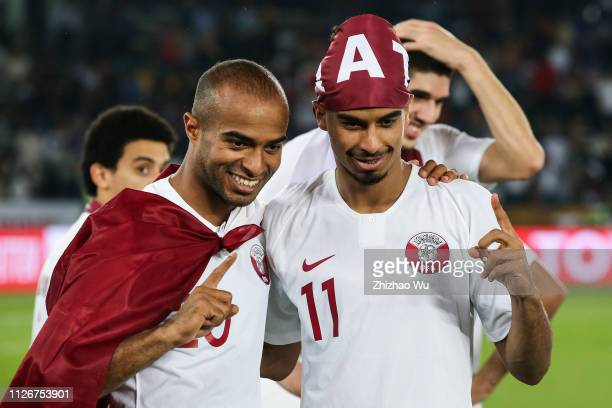 Ali Hassan Afif and Akram Hassan Afif of Qatar celebrate their victory after the AFC Asian Cup final match between Japan and Qatar at Zayed Sports...