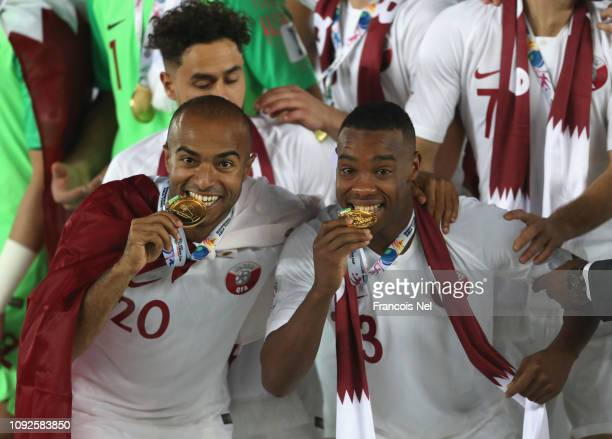 Ali Hassan Afif and Tameem Mohammed Almuhaza of Qatar celebrate after the AFC Asian Cup final match between Japan and Qatar at Zayed Sports City...