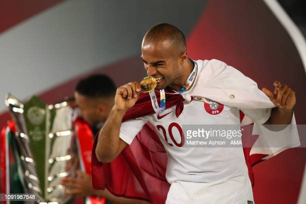 Ali Hassan Afif of Qatar celebrates with his winners medal at the end of the AFC Asian Cup final match between Japan and Qatar at Zayed Sports City...