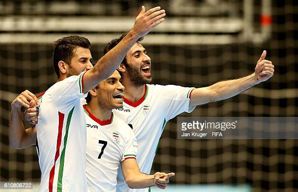 Ali Hassan Zadeh of Iran celebrates his goal with team mates during the FIFA Futsal World Cup semifinal match between Iran and Russia at Coliseo Ivan...