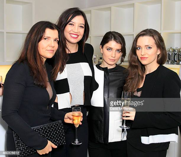 Ali Hewson Daisy Lowe Eve Hewson and Jordan Hewson attend the Edun Pre Fall Dinner at Alison Jacques Gallery on December 11 2014 in London England