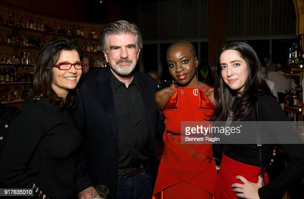 Ali Hewson Tom Freston and Danai Gurira and Meagan Bond pose for a picture during the Danai x One x Love Our Girls celebration at The Top of The...