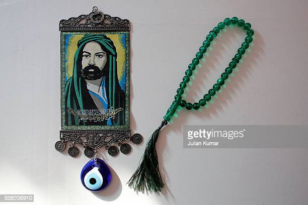 Ali Ibn Abi Talib (Ali) pendant and prayer beads. Muhammad's son-in-law and cousin Ali is believed by Shia muslims to be Muhammad's successor in the Caliphate.