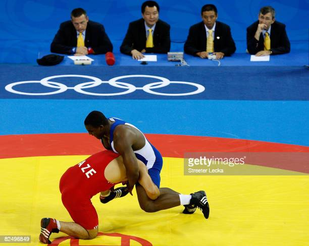 Ali Isayev of AZE competes against Disney Rodriguez of Cuba in the men's 120kg freestyle wrestling event held at the China Agricultural University...