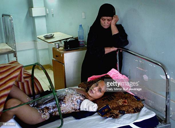 Ali Ismaeel Abbas lays injured in Saddam Hospital April 10 2003 in Baghdad US warplanes fired six satelliteguided bombs at an intelligence building...