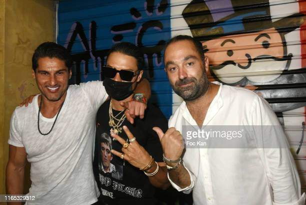 Ali Jassim Street artist Alec Monopoly and Avery Andon attend the Alec Monopoly Performance Party At Gallery BelAir Fine Art SaintTropez on July 30...