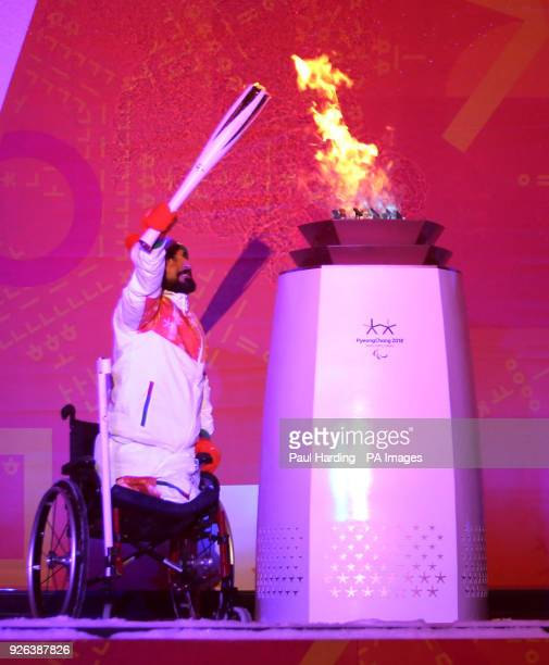 Ali Jawad lights the Paralympic flame during the Paralympic Heritage Flame Lighting Ceremony ahead of the PyeongChang 2018 Winter Paralympic Games at...
