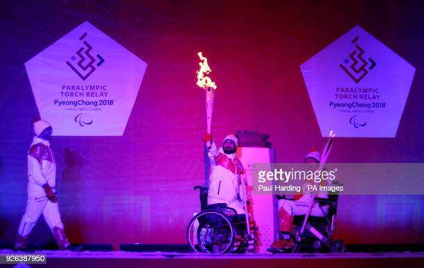 Ali Jawad lights the Paralympic flame watched by Sophie Christiansen CBE during the Paralympic Heritage Flame Lighting Ceremony ahead of the...