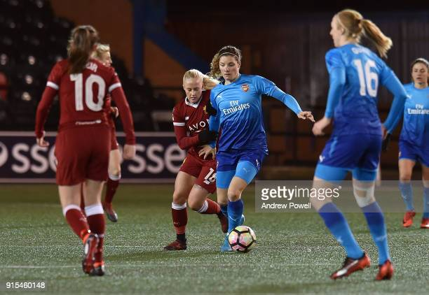 Ali Johnson of Liverpool Ladies competes with Dominique Janssen Arsenal Women during the Women's Super League match between Liverpool Ladies and...