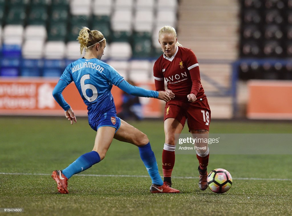 Ali Johnson of Liverpool Ladies competes with Leah Williamson Arsenal Women during the Women's Super League match between Liverpool Ladies and Arsenal Women at Select Security Stadium on February 7, 2018 in Widnes, England.