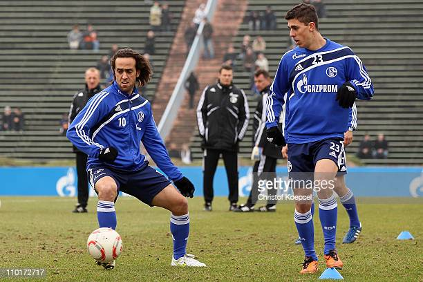 Ali Karimi and Danilo Avelar attend the FC Schalke training session at the training ground at the Veltins Arena on March 16 2011 in Gelsenkirchen...