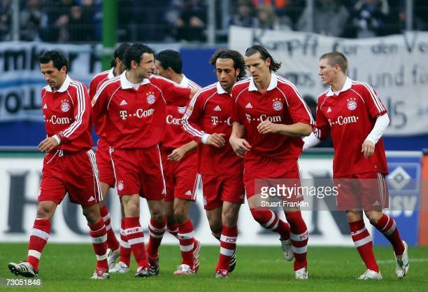Ali Karimi celebrates scoring his goal with players of Munich during the friendly match between Hamburger SV and Bayern Munich at the AOL Arena on...