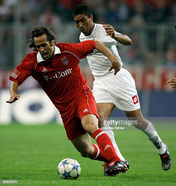 Ali Karimi of Bayern challenges Giovane Elber of Monchengladbach during the Bundesliga match between Bayern Munich and Borussia Monchengladbach at...