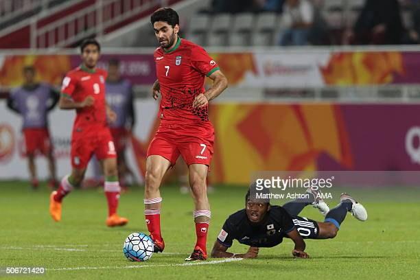Ali Karimi of Iran and Onaiwu Ado of Japan during the AFC U23 Championship quarter final match between Japan and Iran at the Abdullah Bin Khalifa...
