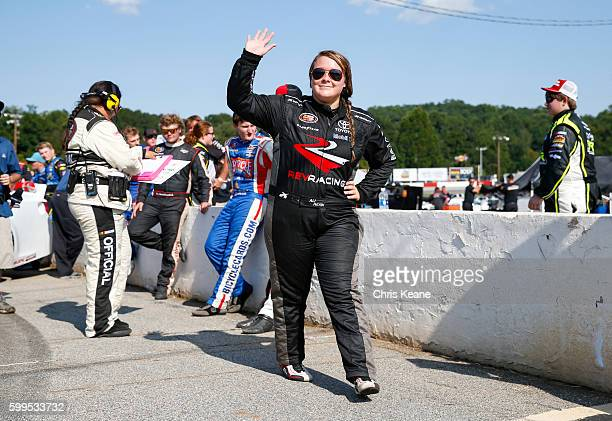 Ali Kern driver of the Max Siegel Inc Toyota waves as she is introduced before the NASCAR KN Pro Series East Kevin Whitaker Chevrolet 140 at...