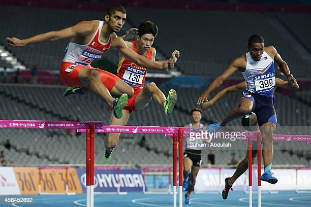 Ali Khamis Abbas Ali Khamis of Bahrain,Cheng Wen of China, Eric Shauwn Cray of Philippines compete in the Men's 400m Hurdles Final on day twelve of...