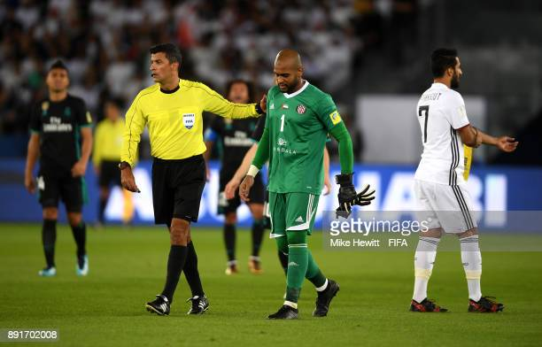 Ali Khaseif of Al Jazira reacts after being forced off through injury during the FIFA Club World Cup UAE 2017 semifinal match between Al Jazira and...