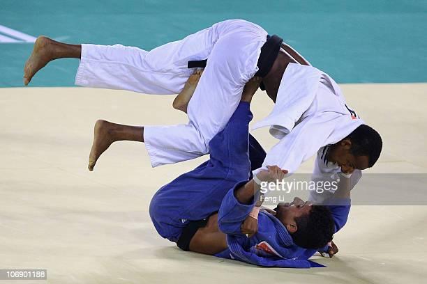 Ali Khousrof of Yemen competes against Eisa Majrashi of Saudi Arabia in the men's judo 60kg preliminary contest at the Huagong Gymnasium during day...