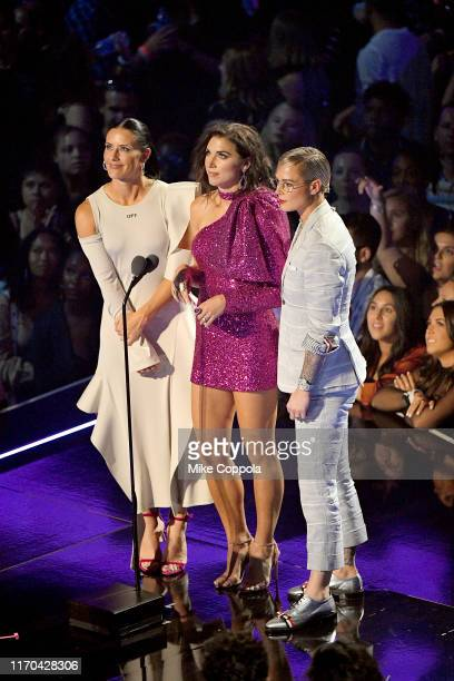 Ali Krieger Alex Morgan and Ashlyn Harris present an award onstage during the 2019 MTV Video Music Awards at Prudential Center on August 26 2019 in...
