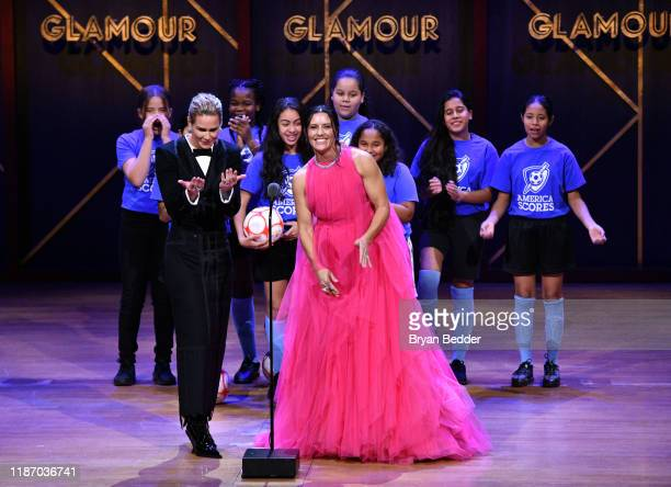 Ali Krieger and Ashlyn Harris speak onstage alongside the Mott Hall Girls soccer team at the 2019 Glamour Women Of The Year Awards at Alice Tully...