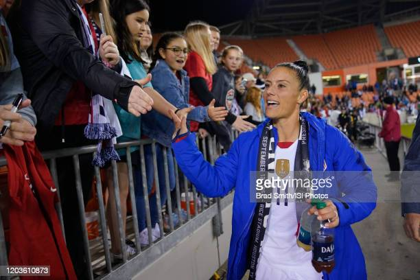 Ali Krieger and fans of the United States celebrate with selfies during a game between Panama and USWNT at BBVA Stadium on January 31 2020 in Houston...