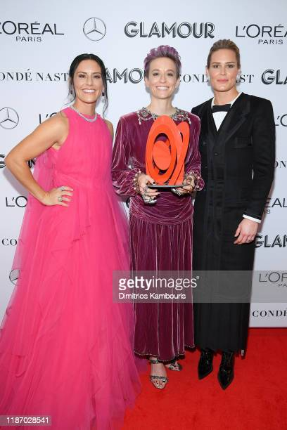 Ali Krieger Megan Rapinoe and Ashlyn Harris attend the 2019 Glamour Women Of The Year Awards at Alice Tully Hall on November 11 2019 in New York City