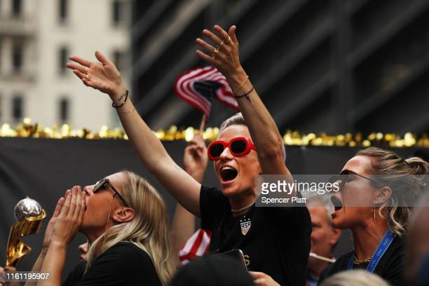 Ali Krieger Megan Rapinoe and Ashlyn Harris celebrate while riding on a float during the US Women's National Soccer Team Victory Parade through the...