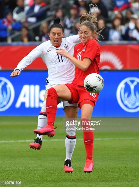 Ali Krieger of the United States and Janine Beckie of Canada and battle for the ball in the first half of the CONCACAF Women's Olympic Qualifying...