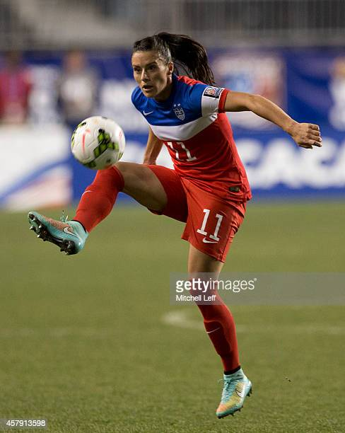 Ali Krieger of the United States controls the ball in the first half against Costa Rica in the 2014 CONCACAF Women's Championship final on October 26...