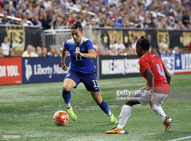 Ali Krieger of the United States drives the ball against Clorene Rateau of Haiti during the second half of the US Women's 2015 World Cup victory tour...