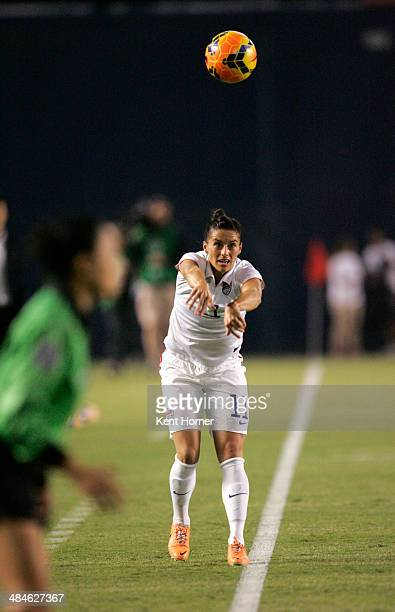 Ali Krieger of the United States throws the ball into play from the sideline in the first half of the game against China during an international...