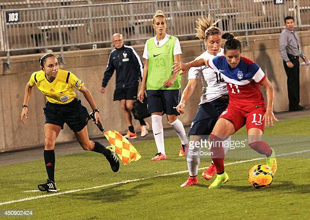 Ali Krieger of the United States tries to keep the ball from Camille Abily of France during the international friendly match June 19 2014 at...