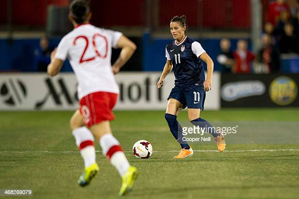 Ali Krieger of the US Women's National Team controls the ball against the Canadian Women's National Team on January 31 2014 at Toyota Stadium in...