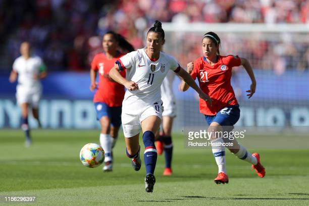 Ali Krieger of the USA runs with the ball under pressure from Rosario Balmaceda of Chile during the 2019 FIFA Women's World Cup France group F match...