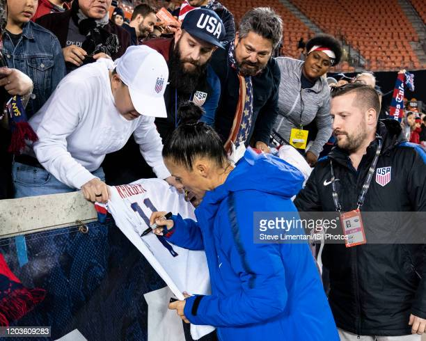 Ali Krieger of the USA signs an autograph after the match during a game between Panama and USWNT at BBVA Stadium on January 31 2020 in Houston Texas