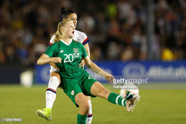 Ali Krieger of United States and Eabha O'Mahoney of Republic of Ireland fight for control of the ball during the second half of the first game of the...