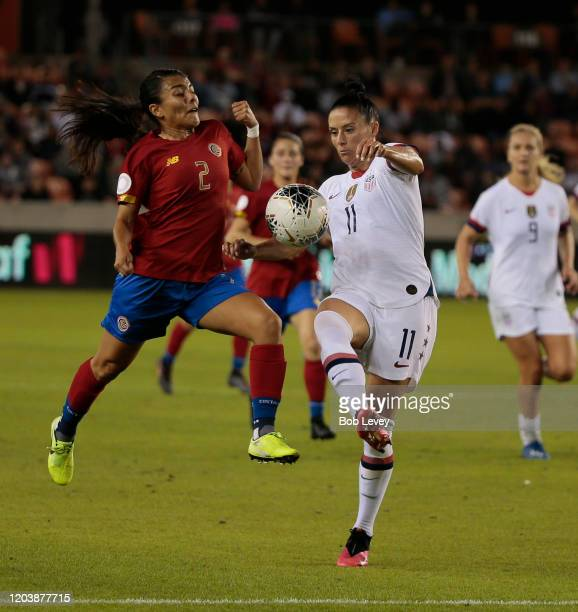 Ali Krieger of United States controls the ball as she is pressured by Gabriela Guillen of Costa Rica during a Group A 2020 CONCACAF Women's Olympic...