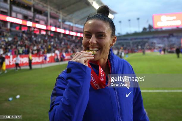 Ali Krieger of USA bites his medal after wining the Final game between Canada and United States as part of the 2020 CONCACAF Women's Olympic...