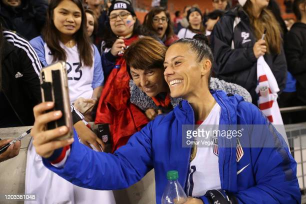 Ali Krieger of USA takes selfies with fans after the CONCACAF Women's Olympic Qualifying group A game between Panama and USA at BBVA Compass Stadium...