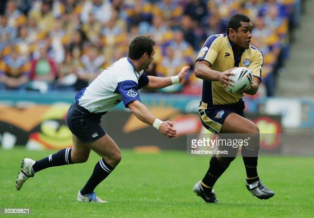 Ali Lauitiiti of Leeds beats the challenge from Jmaes Wynne of Toulouse during the Powergen Challenge Cup semifinal match between Leeds Rhinos and...