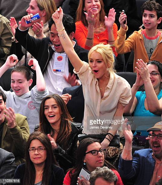 Ali Lohan and Lindsay Lohan attend the Memphis Grizzlies vs New York Knicks game at Madison Square Garden on March 17 2011 in New York City