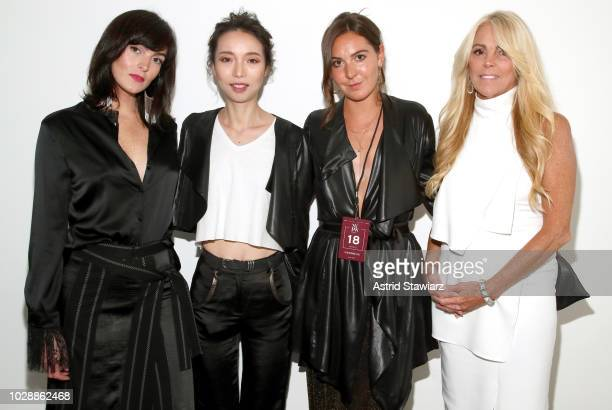 Ali Lohan designer Vivienne Hu Samantha Myer and Dina Lohan pose backstage for the Vivienne Hu show during New York Fashion Week The Shows at Gallery...