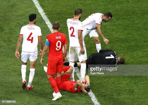 Ali Maaloul of Tunisia checks if team mate Farouk Ben Mustapha is ok during the 2018 FIFA World Cup Russia group G match between Tunisia and England...