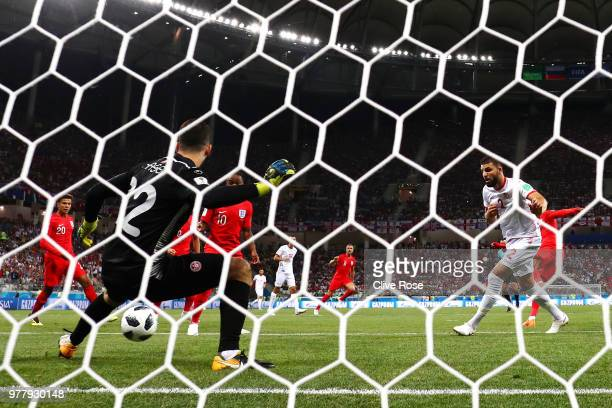 Ali Maaloul of Tunisia makes a save from Jesse Lingard of England during the 2018 FIFA World Cup Russia group G match between Tunisia and England at...