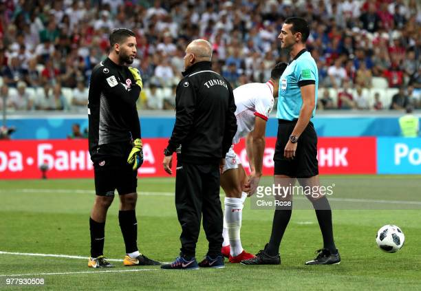 Ali Maaloul of Tunisia talks to Referee Wilmar Roldan during the 2018 FIFA World Cup Russia group G match between Tunisia and England at Volgograd...