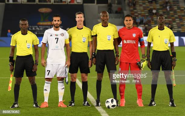 Ali Mabkhout of Al Jazira and Alfonso Blanco of CF Pachuca line up with the match officals prior to the FIFA Club World Cup UAE 2017 third place play...