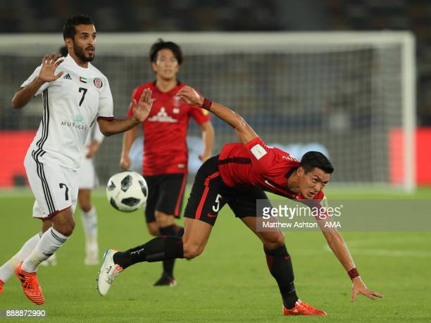 Ali Mabkhout of Al Jazira competes with Tomoaki Makino of Urawa Red Diamonds during the FIFA Club World Cup UAE 2017 match between Al Jazira and...